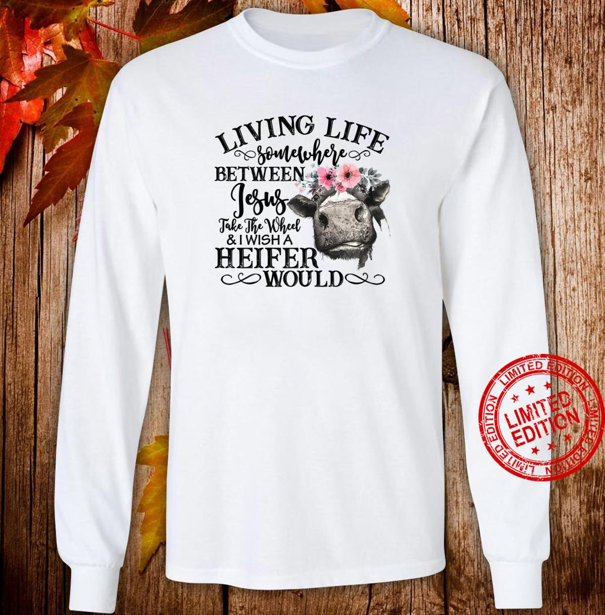 Womens Living Life Somewhere Between Jesus And Heifer Sarcastic Shirt long sleeved